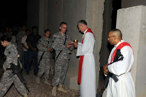 an armed vested deacon Good Friday Iraq