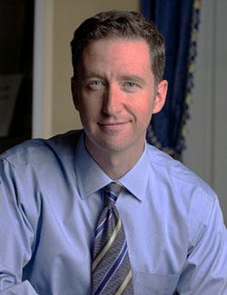 Dr Denis McNamara